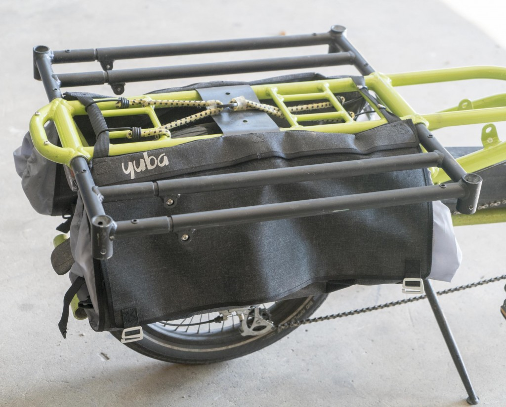 The Carry-On racks are incredibly useful in the upper position to work as a faltbed. Note the Two Go bags fit on the bike no matter where you have the rear rack positioned.