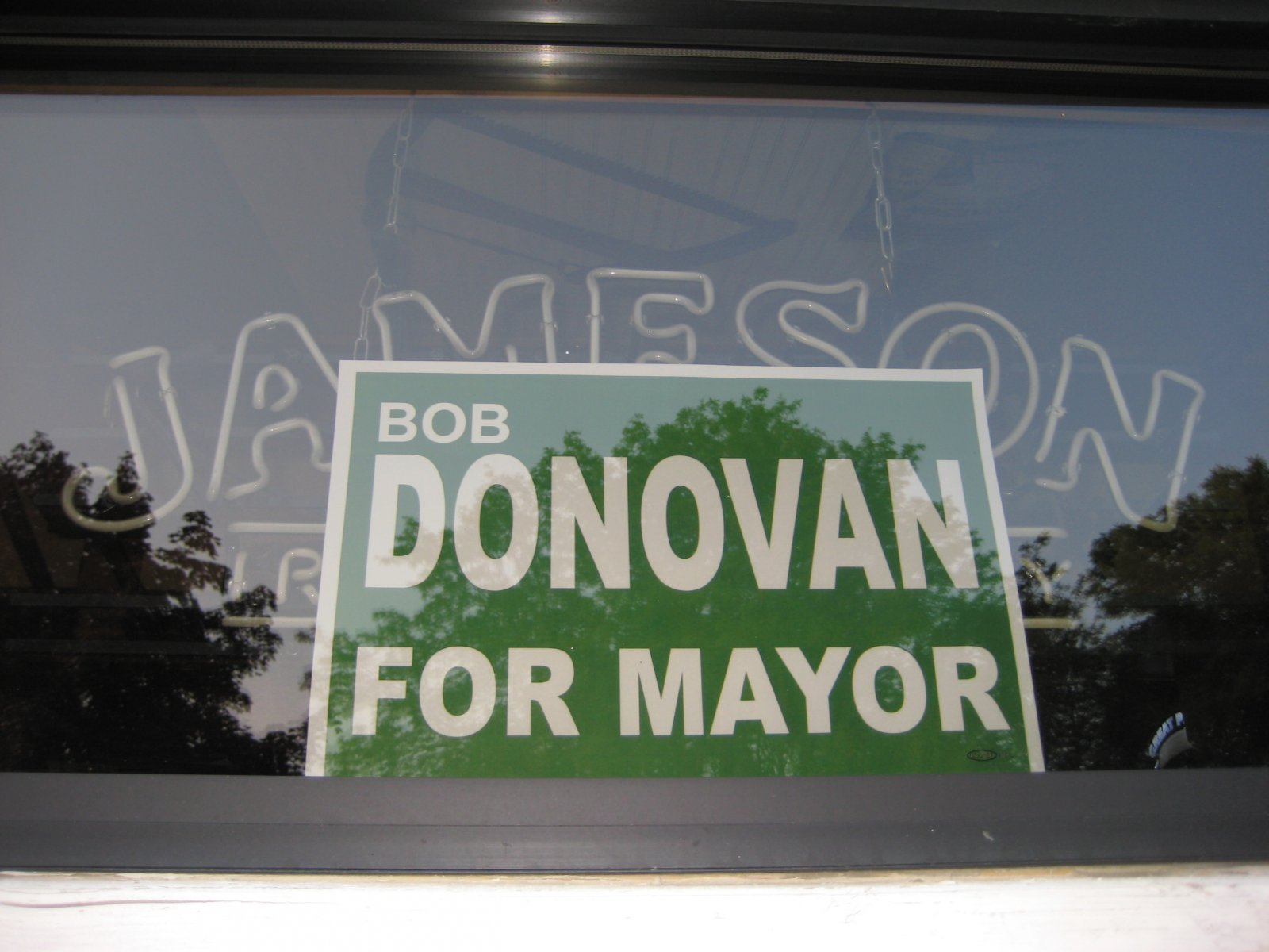 A Donovan for Mayor sign hangs in the window of McKiernan's Pub. Photo by Michael Horne.