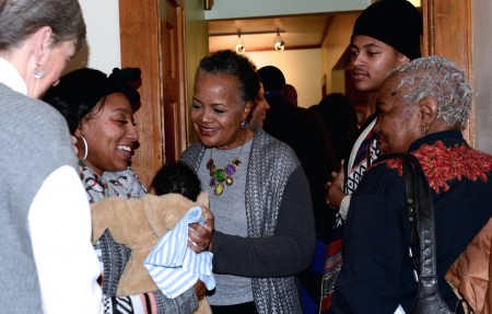 Sharon Adams mingles with community members during a recent event held to pay tribute to her and her work at Walnut Way. Photo by Sue Vliet.
