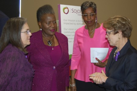 (From left) Carmen Pitre, CEO, Sojourner Family Peace Center; Thelma Sias, vice president for local affairs, WEC Energy Group; Cecelia Gore, executive director, Brewers Community Foundation; and Peggy Troy, CEO, Children's Hospital of Wisconsin chat at the center's grand opening. Photo by Andrea Waxman.