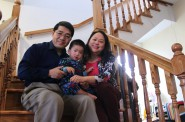 The Rev. Wang Chao Lee, wife Phua and son Yohan, along with family and members of their church, worked for more than a year rehabbing their new home. Photo by Matthew Wisla.