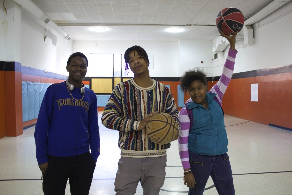 Rodney McCoy, Cameron Henderson and Zuriah Haynes pose during their basketball game. Photo by Emmy A. Yates.