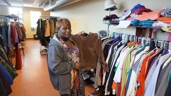 Monica Walter arranges clothing donations at Repairers of the Breach near 14th & Vliet. Photo by Mark Siegrist.