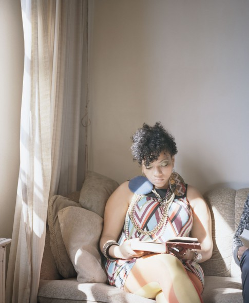 Carrie Schneider American, b. 1979. Abigail reading Angela Davis (An Autobiography, 1974) from the series Reading Women (2012–2014). Courtesy of the artist and Monique Meloche Gallery
