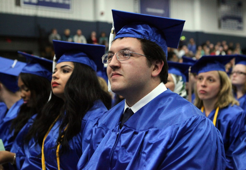Ien Roder-Guzman, 24, recently graduated with a two-year liberal arts degree from Madison College. He credits the learning center at Packer Townhouses with encouraging him to continue his education. Photo by Coburn Dukehart of the Wisconsin Center for Investigative Journalism.