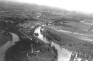 """View (facing northwest) of the east oxbow area and natural """"drainage lake"""" in Lincoln Park in early 1930s prior to construction of the Estabrook Dam."""
