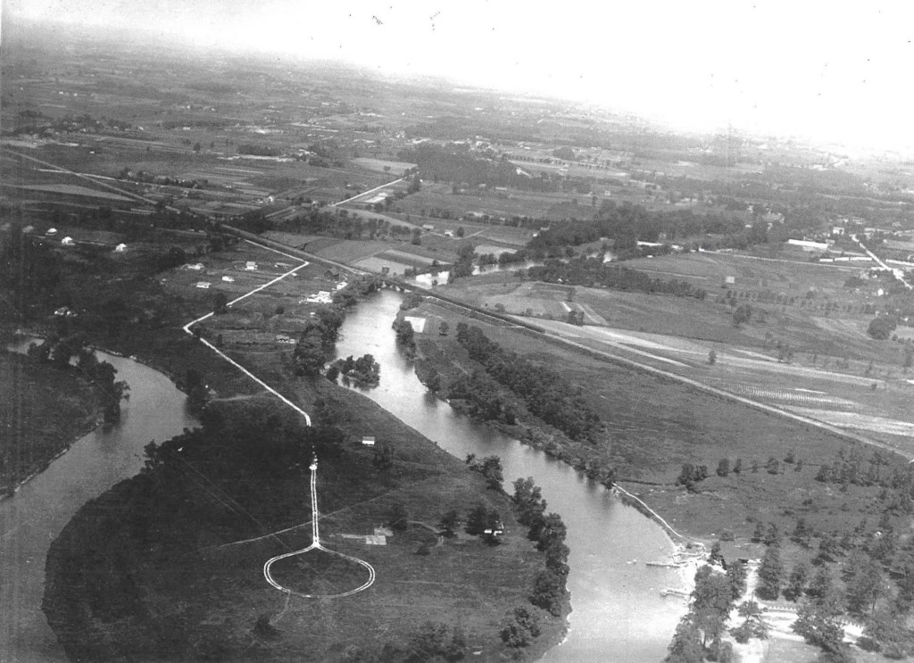 "View (facing northwest) of the east oxbow area and natural ""drainage lake"" in Lincoln Park in early 1930s prior to construction of the Estabrook Dam."