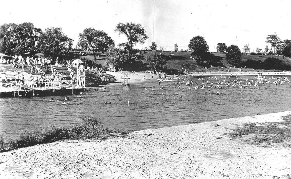 Estabrook Park Beach in 1937. It was located directly opposite the Blue Hole – a 15 acre quarry lake connected to the river that was used as a landfill by the City of Milwaukee beginning in the 1950s -- a decision that, along with increasing water quality issues, ended use of this beach.