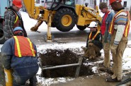 City of Madison crews replace lead service lines leading into a home. The city's decade-long lead pipe replacement program, begun in 2001, is considered a model of how to remove harmful lead from municipal water systems. Current federal regulations require only replacement of utility-owned lead pipes, which can increase rather than decrease lead levels in water. Photo from the Madison Water Utility.
