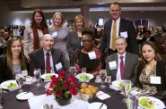 Tom Schneider, executive director of COA Youth & Family Centers (second from right, seated) gathers with colleagues at the MANDI event. Schneider accepted the BMO Harris Bank Cornerstone Award on behalf of his organization. Photo courtesy of NNS.