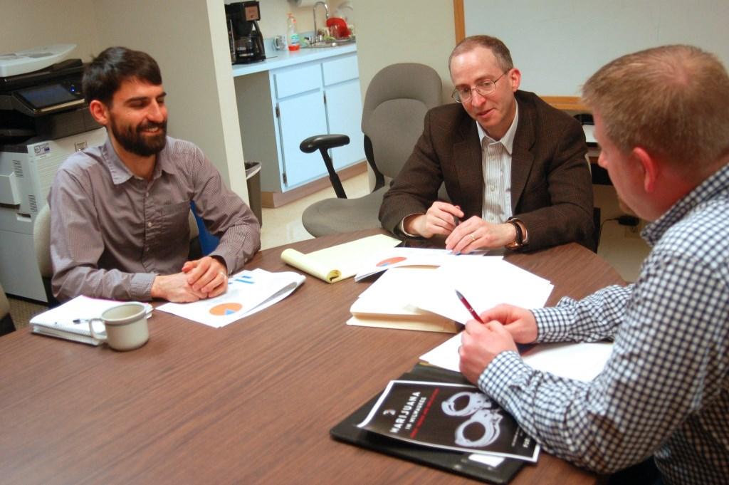 Rob Henken, Public Policy Forum president (center) and researchers Joe Peterangelo (left) and Jeff Schmidt discuss the report. Photo by Edgar Mendez).