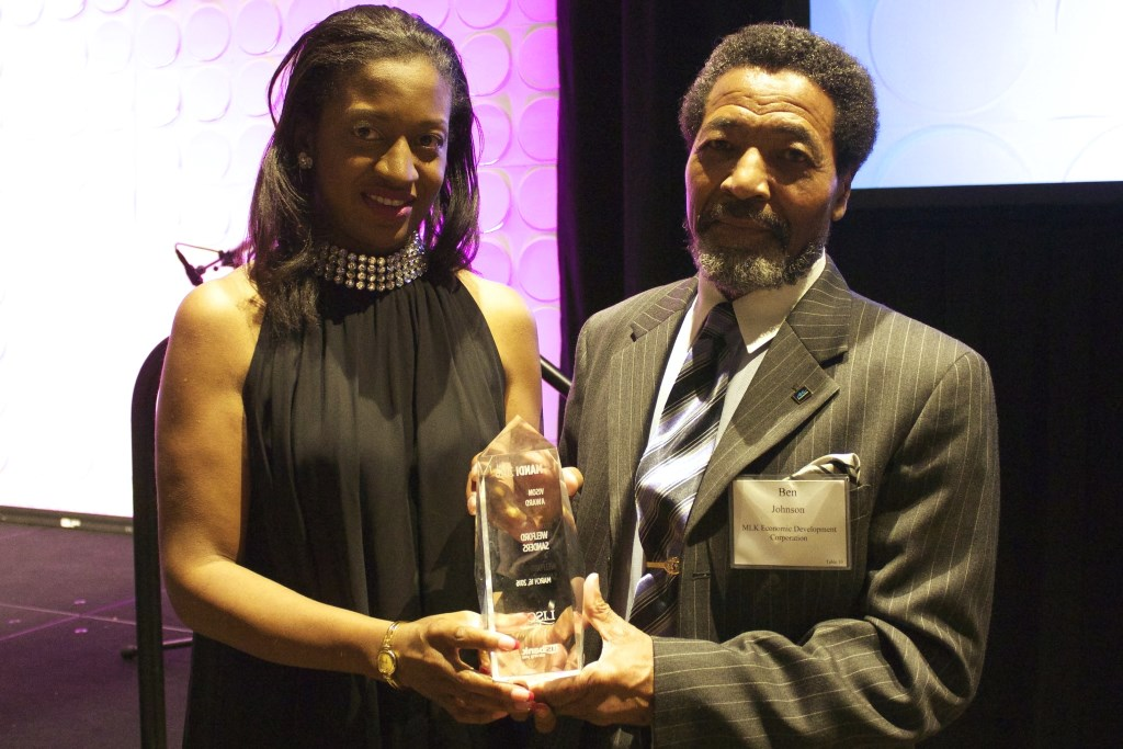 Dawn Sanders Cavilla, daughter of the late Welford Sanders, and Ben Johnson, chariman of the Martin Luther King Economic Development Corp. board, pose with the Vision Award, presented posthumously to Sanders. Photo courtesy of NNS.
