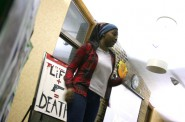 Kaliah Hughes-Bester, 15, performs a poem she wrote called 'Behind the Gun.' Photo by Jabril Faraj.