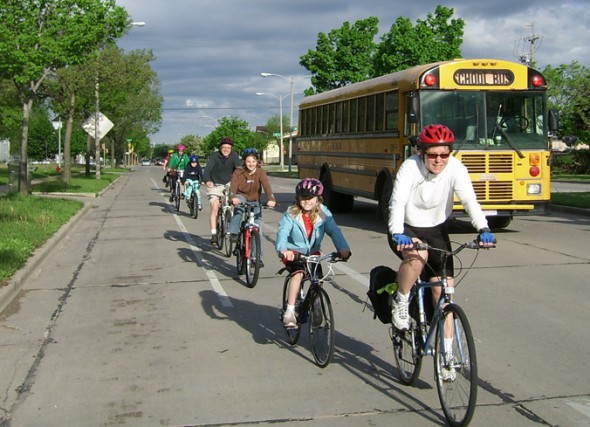 A Bike Fed Ambassador leading a group of children biking to school. Photo courtesy of the Wisconsin Bike Fed.