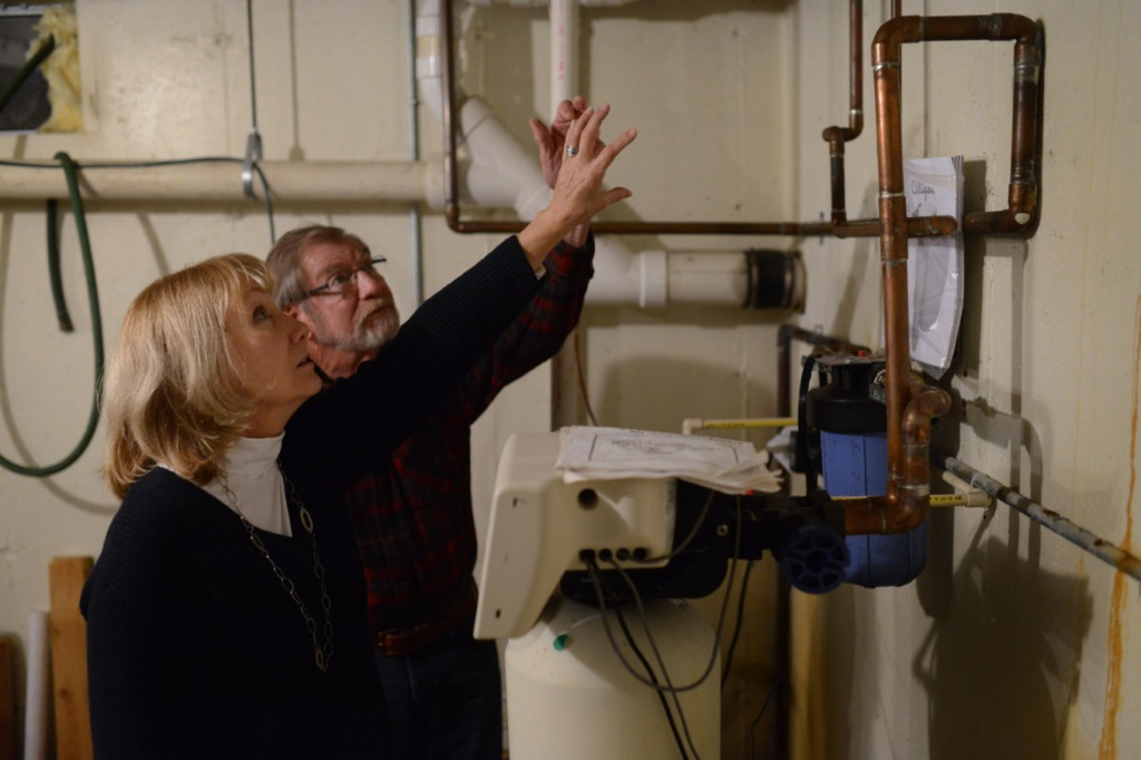 Vicky and Bud Harris of rural De Pere point out the filtration system they installed in their home that removes strontium and other contaminants from their drinking water. The U.S. Environmental Protection Agency is studying whether to begin regulating strontium, which is found in some of the highest concentrations in the nation in drinking water in eastern Wisconsin. Photo by Kyle Bursaw of Press-Gazette Media.