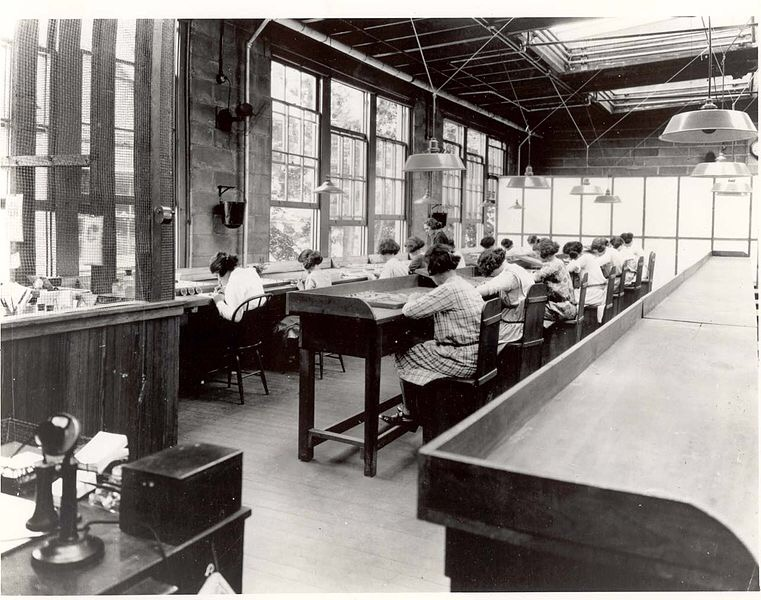 "From 1917 to 1926, U.S. Radium Corp. in Orange, New Jersey, produced glow-in-the-dark products. The plant employed over a hundred workers, mainly women, to paint radium-lighted watches and instruments. Dozens of ""radium girls"" came down with radiation sickness and died, demonstrating the dangers of high-level radium exposure. Low-level exposure in drinking water remains understudied. Photo courtesy of Rutgers University."