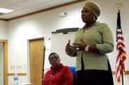 Dana World-Patterson and Martha Love address the Human Trafficking Task Force at a monthly meeting. Photo by Allison Dikanovic.