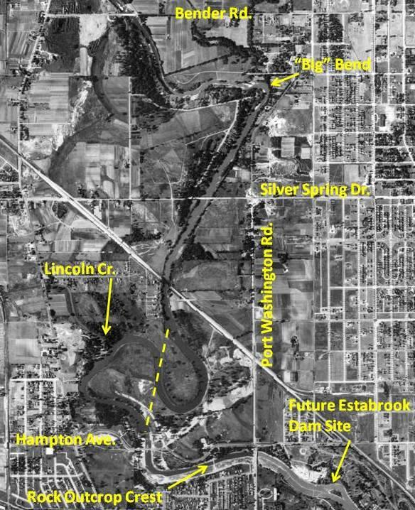 "1937 aerial photograph showing historic meander of the Milwaukee River in Lincoln Park prior to construction of the Estabrook Dam and 3,000-ft long by 200-ft wide ""center-cut"" (yellow dashed line). Widening and deepening of the river channel and rock outcrop is completed upstream of future dam site to the temporary cofferdam just upstream of Hampton Ave. bridge. Planning documents stated the rock outcrop backwater effect extended 3 miles upstream which coincides with the ""big bend"". Source: Milwaukee County Interactive GIS Mapping website."