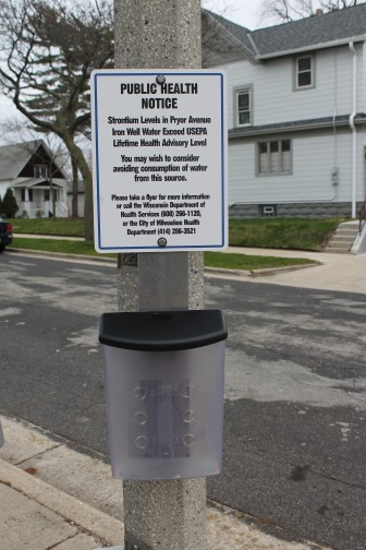 Milwaukee posted this warning about high strontium levels in spring 2015 on the popular public well where residents fill up drinking water jugs in the city's Bay View neighborhood. The U.S. Environmental Protection Agency is considering regulation of this naturally occurring metal, which is found in the highest concentrations nationwide in southeast Wisconsin. Consumption of strontium can lead to bone and tooth problems in children. Photo by Katherine Keller of the Bay View Compass.