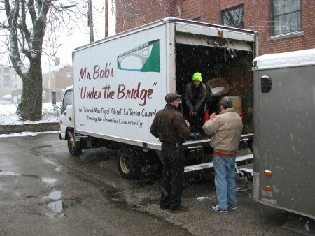 Mr. Bob's Under the Bridge volunteers unload a truck in the parking lot of Redeemer Lutheran Church. Photo by Brendan O'Brien.