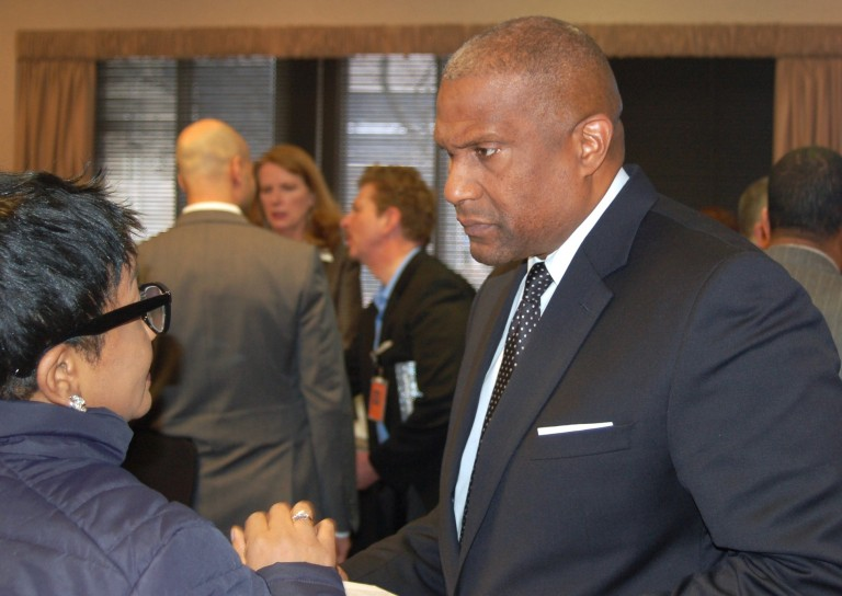 PBS Host Tavis Smiley greets MATC community leaders at a reception at the downtown campus after taping his program. Photo by Andrea Waxman.