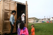 Neighborhood children enter the portal. Photo by Jabril Faraj.