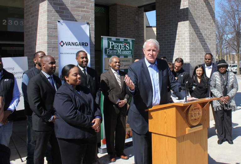 Mayor Tom Barrett and District 6 Ald. Milele Coggs (left) announce that a Pete's Fruit Market is coming to Bronzeville. Photo by Mark Doremus.