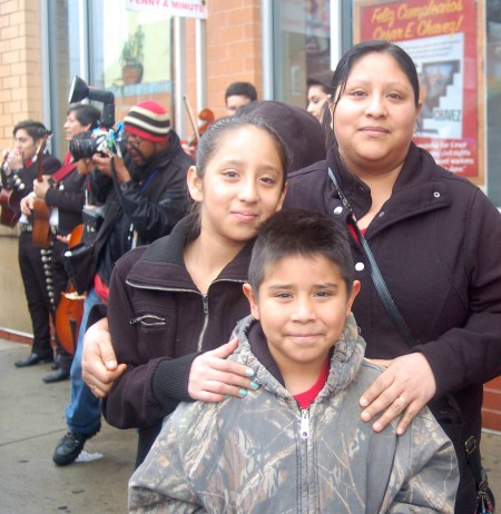 Araceli Gonzalez, her daughter Conrada and son Sal, joined hundred of residents for the unveiling of the Cesar E. Chavez statue at the Supermercado El Rey pedestrian plaza recently. Photo by Edgar Mendez.