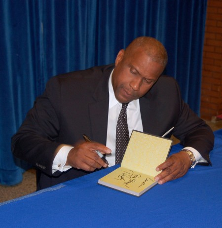"""Tavis Smiley signs copies of his new book, """"50 for Your Future"""" at MATC. Photo by Andrea Waxman."""