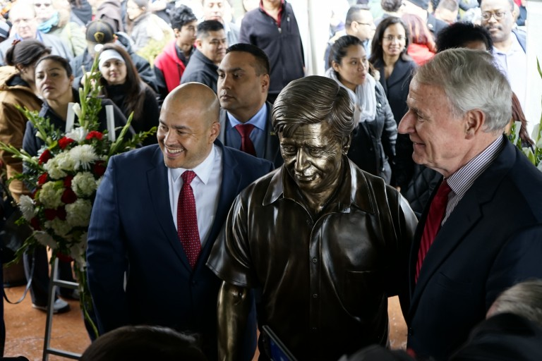 District 12 Alderman Jose Perez and Milwaukee Mayor Tom Barrett pose next to the statue during the ceremony. Photo by Adam Carr.