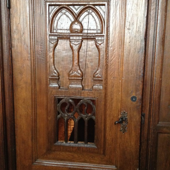 Carved wooden doors. Photo by Cari Taylor-Carlson.