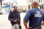 Mario Sinclair interviews Darin Jones near the Milwaukee Public Museum, across from the firehouse where he works. Photo by Emmy Spring.