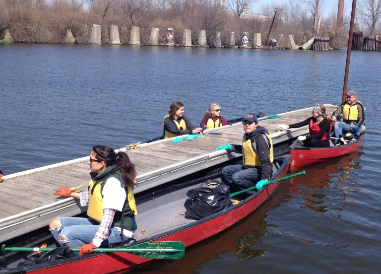 Volunteers collect garbage in the water using canoes during the annual event. Photo courtesy of Milwaukee Riverkeeper.