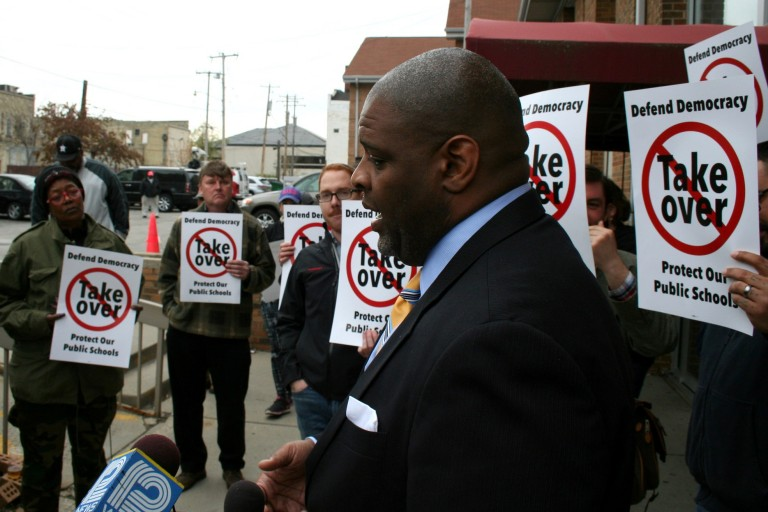 Demond Means speaks to reporters before an OSPP advisory committee meeting. Photo by Jabril Faraj.