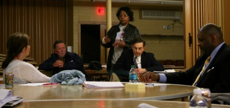 Marva Herndon addresses Debra Jupka (left), Demond Means (right) and others at the advisory committee meeting. Photo by Jabril Faraj.