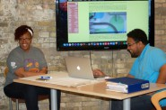 MKEGrind owners Sylvia and Thomas Wilson lead a workshop on branding for students at the Arts @ Large Gallery. Photo by Andrea Waxman.