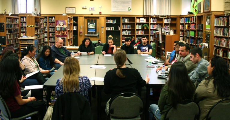 A group of staff, parents and students meet at the Pulaski library. Photo by Jabril Faraj.