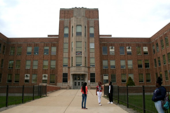 Students stand in front of Pulaski's main entrance. Photo by Jabril Faraj.