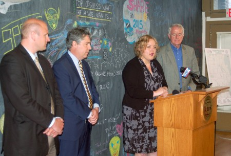 Aldermen Nik Kovac (left) and Michael J. Murphy joined Beth Haskovec, executive director of Artists Working in Education, and Milwaukee Mayor Tom Barrett to announce a $50,000 grant to fund an art component of MKE Plays. Photo by Edgar Mendez.