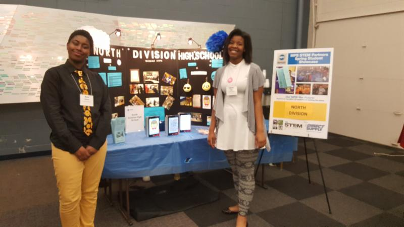 North Division students Qiaira Matthews (left) and Tatiana Loyd (right) showcase their mobile app -- which is now one of six winners in a national competition -- at the MPS STEM Partners Spring Student Showcase. Photo courtesy of MPS.