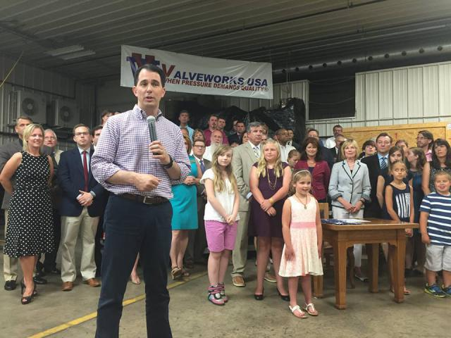 Governor Scott Walker signs the 2015-17 State Budget into law at Valveworks USA in Waukesha. Photo from the State of Wisconsin.
