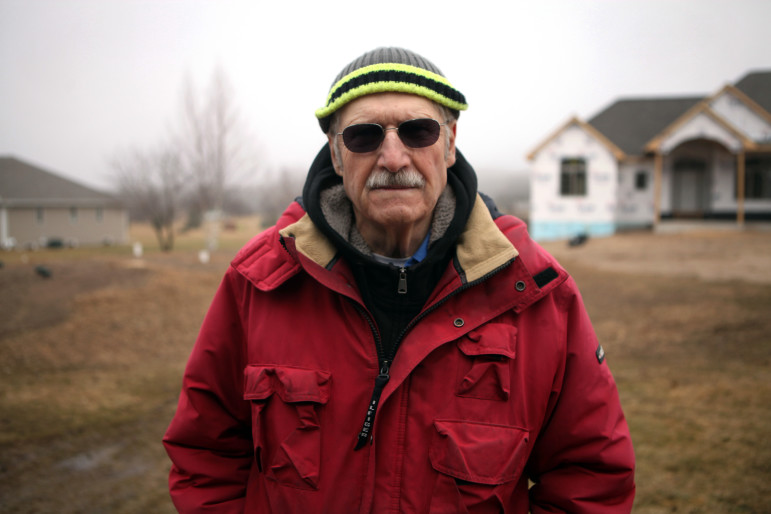 John Teichtler, Door County sanitarian, is seen near a property his office inspected during the construction of its septic mound system. The Door County Sanitarian Department was created in the mid-1960s by the county board because of concerns that failing private sewage disposal systems were contaminating drinking water. Teichtler has worked for the department since 1971. Photo by Coburn Dukehart of the Wisconsin Center for Investigative Journalism.