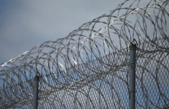 Razor wire tops one of the fences at the Lincoln Hills School for Boys and Copper Lake School for girls complex in rural Irma, Wis. Federal criminal and civil rights investigations probing allegations of abuse of juvenile offenders are underway at the facilities. Photo by Dan Young of the USA TODAY NETWORK-Wisconsin.