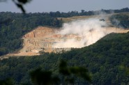 A blasting operation at Pattison Sand Co.'s surface mine in Iowa is seen on Sept. 14, 2015, from across the Mississippi River in Bagley, Wis. Homeowners Jim and Kathy Kachel say dust from the mine has gotten inside of their home. Photo courtesy of Jim Kachel.