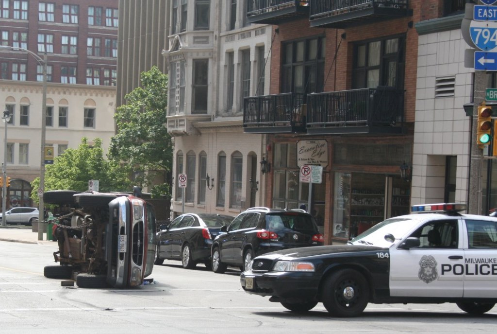 Accident on E. Mason St. Photo by Jeramey Jannene.