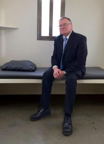Rick Raemisch, executive director of the Colorado Department of Corrections, sits in a cell similar to the one where he spent nearly a day in 2014. Raemisch found himself pacing, losing track of time and counting nicks in the wall to occupy his mind. And he was there for just 20 hours — not the 20-plus years some Colorado inmates had endured before the state eliminated indefinite use of solitary confinement. Photo by Adrienne Jacobson of the Colorado Department of Corrections.