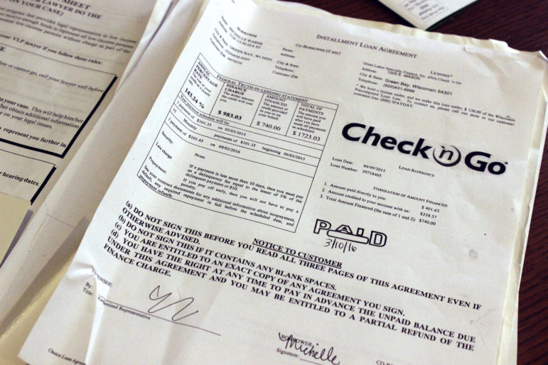 """The truth-in-lending box on Michelle Warne's loan explains how much she owes. With principal, interest and fees, the $740 loan will cost her $1,723. """"I wish I would have read the fine print,"""" she said. Photo by Bridgit Bowden of Wisconsin Public Radio."""