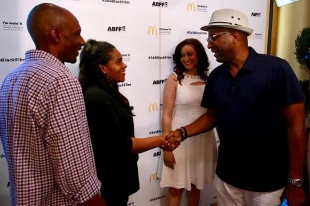 Wardlaw shakes hands with director Malcolm Lee at the Ritz-Carlton Hotel in Miami Beach during the 20th Annual American Black Film Festival last month, as the other finalists look on. Photo courtesy of the American Black Film Festival.