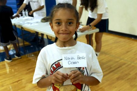 Trejuan Talley, 6, enjoys participating in a spelling activity during the literacy fair. Photo by Amelia Jones.