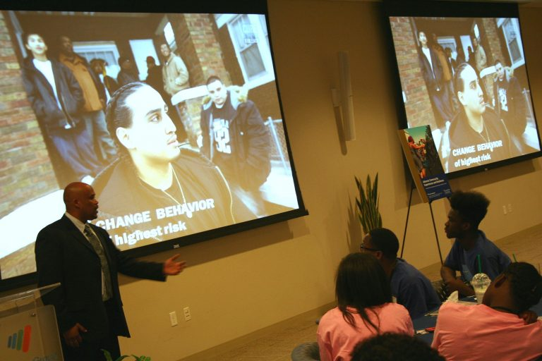Marcus McAllister addresses a group of young people at an Office of Violence Prevention lunch. Photo by Jabril Faraj.